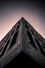 uprising (Drivingwood) Tags: photo black white house building bank germany ravensburg abstract fascade bricks windows pattern symmetrical