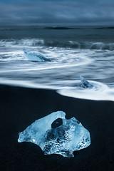 Swirling (jeanineleech) Tags: diamondicebeach icebeach jökulsárlón blacksand streaks water waves ice iceberg swirl ocean stormy morning beach landscape blue