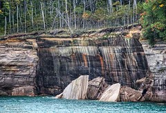 Mineral Stained Sandstone Cliffs, Pictured Rocks National Lakeshore, Michigan (PhotosToArtByMike) Tags: picturedrocksnationallakeshore michigan mi picturedrocks upperpeninsulaofmichigan upperpeninsula up sandstonecliffs uppermichigan lakesuperior munising autumn autumnleaves rockycoastline mineralstain mineralstreaks