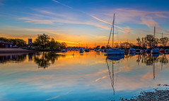 Quay Reflections (nicklucas2) Tags: quay christchurch river sunrise stour sun bird swan reflection water contrail yacht boat priory dorset