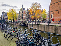 Amsterdam (ashustravels1) Tags: europe travel vacation canal scooter bicycle architecture waterways ancient city urban bustling metropolitan buidings
