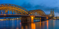 Blue hour at cologne cathedral - Blaue Stunde am Kölner Dom (ralfkai41) Tags: köln night cologne architektur nightshot brücke blauestunde reflexion nachtfotografie architecture panorama colognecathedral langzeitbelichtung flus mirroring water cathedral bridge panoramic bluehour river city spiegelung rhein hohenzollernbrücke dom reflektion wasser stadt kölnerdom