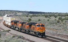 BNSF ET44C4 3881 gets the Q-LACCHI2-18 back moving up the hill and through Crookton, Az at milepost 420 after stopping at the signals in the background to let 2 other trains crossover in front of it. (DTR CEO) Tags: stacks locomotive crookton arizona et44c4 bnsf jb hunt jbhunt transcon ge scenic action