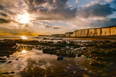 Birling Gap (Prolifephotography) Tags: landscapes seascape sun rocks cliff reflection clouds lowtide seaside beach water drama golden light