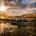 Birling Gap (Prolifephotography) Tags: sun rocks cliff reflection clouds lowtide