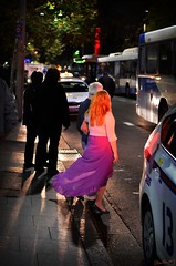Heading home, Circular Quay, Sydney (Dalloway Fish) Tags: street pink light shadow urban orange woman fish bus home night hair photography lights evening couple shadows purple candid taxi emma vivid skirt heading homeward dalloway vividfestival