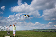 Cheerful Greeting (Cristian Sabau) Tags: show city summer sky horizontal kids clouds children airplane happy photography fly movement technology aircraft horizon extreme flight wide performance skills formation demonstration enjoy romania gras motor transylvania greeting cheering airfield professionalism closeto colorimage scienceandtechnology smokeclouds aviaticshow