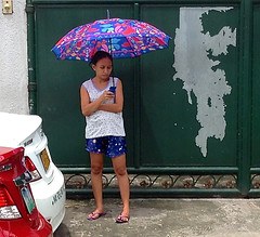 Avon (mikeeliza) Tags: pink blue red woman white green girl car umbrella asian gate peeling paint phone purple arms bare young cell manila denim shorts pinay filipina avon checking pinoy legals mikeeliza