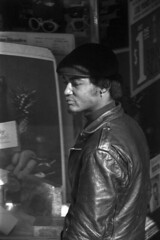 1027B68 19 (ndpa / s. lundeen, archivist) Tags: city people blackandwhite bw man black film monochrome face hat boston 35mm ma blackwhite october candid massachusetts nick citylife streetphotography streetlife storefront africanamerican 1960s 1968 youngman leatherjacket beaconhill hangingout sliceoflife loitering youngpeople charlesstreet storefrontwindow dewolf nickdewolf photographbynickdewolf