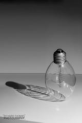 Deluminating (biccies1) Tags: shadow blackandwhite stilllife lamp bulb mono blackwhite filament