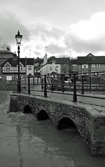 The Tide is High (Song-to-the-Siren) Tags: bridge winter blackandwhite bw digital river arch streetlamp streetphotography guildford floods 2014 riverwey nikonv1