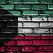 National Flag of Kuwait on a Brick Wall