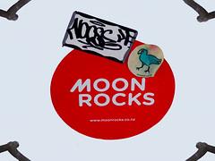Moon Rocks (Steve Taylor (Photography)) Tags: art graffiti streetart sticker black red white paper newzealand nz southisland canterbury christchurch cbd city circle round contrast curlingup unstuck peeling stickybit moonrocks