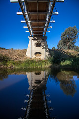 across the water (Daedalus-) Tags: bridge water reflection blue sky australia tharwa canberra efs1018mmf4556isstm