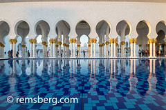 United Arab Emirates - Reflection of arches on water of Sheikh Zayed Mosque in Abu Dhabi (Remsberg Photos) Tags: middleeast abudhabi architecture gold decorative beauty tranquil exotic mighty mosque grandmosque worship sheikhzayedmosque art intricate sunlight pattern detailed tradition bright warm arches water reflection arabic arabian persiangulf emirate unitedarabemirates islam prayer muslim allah islamic religion uae