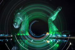Spinning the green Kelpies (Waving lights in the dark) Tags: camerarotation camerarotate rotation rotate rotated kinetic kelpies falkirk scotland practice spinning green night nightphotography afterdark sonyzeiss