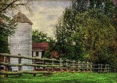 Rails Along the Front (clarkcg photography) Tags: wood rail fence post silo house trees rain grass oklahoma fencedfriday