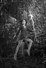 Flying Beauty (Arief Setiawan) Tags: indonesia asian southeastasia morning summer tropical blackandwhite bw monochrome scenic elevatedview lowangleview outdoor levitate levitation leaf fashion casual jump beauty woman female health forest fire torch denpasar bali