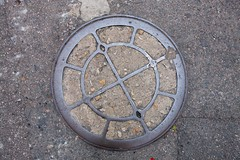 Manhole cover in Hong Kong (Stan de Haas Photography) Tags: asphalt background circle city cover dirty drain drainage grunge hole industrial infrastructure japan lid manhole metal old round rusty sewer shape steel street surface texture urban hong kong hongkong