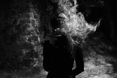 noir city (Emiliano Grusovin) Tags: night mood filmnoir smoke lady girl cigarette city urban bw darkness ambience fujifilmxe1 xf18mmf2r blackandwhite oldtown hat femmefatale