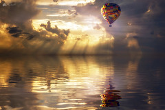 Where angels fly... (Kerriemeister) Tags: crepuscular rays raysofgod raysoflight clouds cloud cloudscape sky hot air balloon reflection reflected water creation creative composite composition photomanipulation photoshop digital art imagination fantasy
