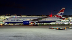 British Airways 777 At Night. (spencer.wilmot) Tags: terminal5 egll evening sideon airside heathrow heavy huge tripleseven 777 777200 777236er 777200er b772 b777 britishairways boeing ba baw speedbird strobes navigationlights apron ramp lhr london longhaul night nighttime nightshoot airsideops aviation aircraft airplane airliner airport departure pushback civilaviation dusk jet jetliner plane twin taxiway widebody gymmt beacons