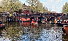 Amsterdam. (alamsterdam) Tags: amsterdam kingsday brouwersgracht bridge orange boats people