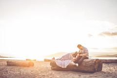 fireproof (emmylou.virginia) Tags: light sunset portrait woman canada man love beach vancouver sand hands couple sweet logs together blanket inlove vancouverengagementphotographer emmylouvirginiaphotography vancouvercouplesphotographer vancouverlovestoryphotographer locardobeach