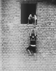 2 little children (MelaniaAndreea) Tags: bw childhood wall children little brothers grain seeds helpfull