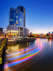 River of Colours (Scintt) Tags: city travel light sunset urban tourism water architecture modern night buildings flow evening boat hall twilight singapore long exposure slow place dusk vibrant trails quay shutter colourful clarke raffles scintillation scintt