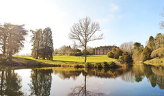 First Sun of Spring (Matthew Thompson (old)) Tags: england sun lake reflection tree water countryside hall spring university bare calm serenity flare keele mgthompson