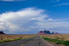 Monument Valley, Utah (Leonid Yaitskiy) Tags: road park trip travel sky usa monument grass rock clouds america utah us bush nikon highway rocks indian united roadtrip national valley states reservation leonid d90 prerie yaitskiy