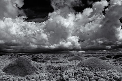 Chocolate Hills in B&W Infrared (Shutter wide shut) Tags: bw tourism clouds ir philippines highcontrast canoneos20d infrared bohol drama canonef1740mmf4lusm chocolatehills bwinfrared centralvisayas niksilverefexpro2 agfaapxpro100film irmodifiedcanoneos20d