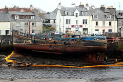 The wreck (mootzie) Tags: street black seaweed yellow boat wooden boom shops railing wreck tyres propellor destroy stornoway