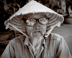 Da Lat Man #2 (mckenart) Tags: travel portrait people film candid pipe streetphotography vietnam dalat v700 conicalhat