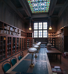 forgotten days (cherryspicks (on/off)) Tags: interior library architecture desk lamp shelves books archive room stainedglass