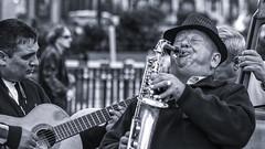 Street musicians (Frank Fullard) Tags: frankfullard fullard busker music musician street portrait saxaphone guitar harmony song madrid spain espania happy enjoyment hat