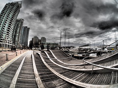 Wave Deck, Queen's Quay, Toronto (creditflats) Tags: mft toronto samyang rokinon 75mm fisheye queens quay wavy deck waterfront olympus ep5 pen city cityscape ontario canada clouds curves wave