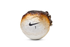 Scorched (Bill Hornstein) Tags: nike nikegolf ball burned charred fire golf golfball hot melt scorched