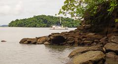 The Panamanian coastline (Marc.van.Veen) Tags: panama boat coast coastline green plants water sea rocks