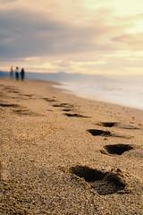 A piccoli passi (Caterina Zito) Tags: silhouette sea footprints sand sky shallowdof