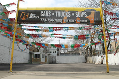 Buy Here, Pay Here (Flint Foto Factory) Tags: chicago illinois urban city spring april 2017 north edgewater neighborhood closed outofbusiness used car dealer dealership rea motors 5828 nbroadway ardmore streamers shiny sparkly buyherepayhere empty lot sunday afternoon