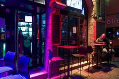 Lyon - A la terrasse d'un bar. (Gilles Daligand) Tags: lyon rhone nuit bar bistrot terrasse homme éclairage multicolore leica q restaurant détendstoiencore quartierruemercière