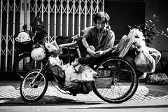 Saigon 17 (arsamie) Tags: saigon vietnam ho chi minh street man anh oi bike motorbike life people candid black white monochrome bread banh mi