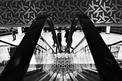 (formwandlah) Tags: kaiserslautern k lautern shopping center mall einkaufszentrum street photography rolltreppe escalator urban city noir dark strange melancholic melancholisch sureal bizarr skurril abstrakt abstract darkness light bw blackwhite black white sw monochrom high contrast ricoh gr pentax formwandlah thorsten prinz einfarbig surreal architecture architektur tower turm babel hochhaus rathaus finsternis dramatic sky wolken düster outdoor minimalismus schärfentiefe gebäude clouds lines silhouette silhouettes himmel shadow shadows schatten melancholie melancholia silhouetten