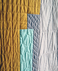 City Planner detail (Quiltachusetts - Heather Black) Tags: modern contemporary quilt quilting 3d yellow mustard aqua coral orange grey gray solid geometric quiltachusetts patchwork magazine pattern design