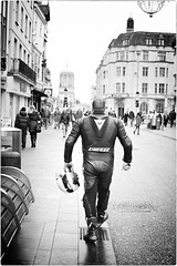 Mad Max (Steve Lundqvist) Tags: england inghilterra uk kingdom united people street streetphotography shooting snap oxford oxfordshire regno unito motard biker motociclista tuta leather rear back dainese overalls tracksuit mad max helmet motorcyclist rider centauro outrider nikon