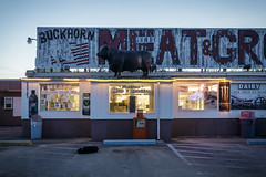 Buckhorn Meat and Grocery II (Notley) Tags: missouri route66 oldroute66 showme showmeroute66 httpwwwnotleyhawkinscom missouriphotography notleyhawkinsphotography ruralphotography sign signs highwayattractions bluehour thebluehour pulaskicounty buckhornmeatandgrocery notley notleyhawkins 10thavenue dog parkinglot evening dusk storefront store