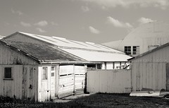 Schrader Marketing Center (Jim Frazier) Tags: wood old summer blackandwhite bw art texture monochrome sepia architecture rural buildings landscape wooden illinois rust scenery peeling paint cattle market decay country rustic stock barns scenic structures rusty july architectural il frame worn weathered desaturated aged agriculture peelingpaint decrepit livestock dakota q3 agricultural hogs rundown oldified 2013 ldjuly ©jimfraziercom wmembed ld2013