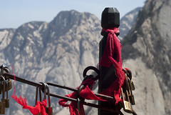 Hua Shan Post (William J H Leonard) Tags: china trees winter red mountain mountains fence landscape asian religious rocks asia flag chinese sunny flags cliffs clear xian sacred locks charms taoist taoism shaanxi eastasia eastasian huashan sacredmountain mounthua westernmountain earthasia xiyue